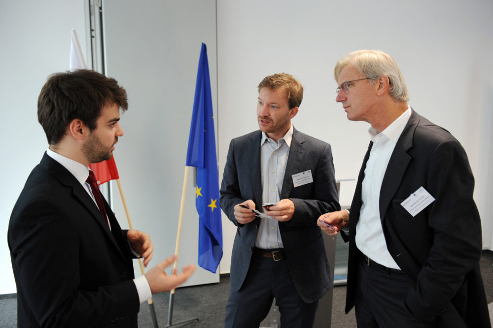 9. From left Mr Aleksander Śniegocki Mr Thomas Stehnken and Mr Bertrand van Ee